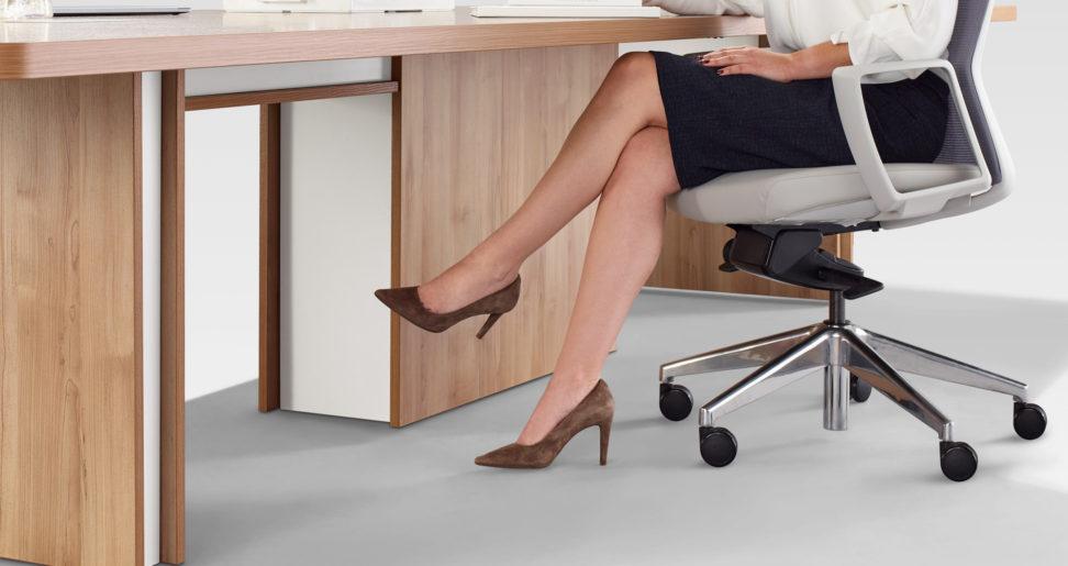 Lady at Tayco Desk Sitting Down